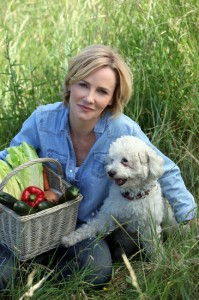 Woman with dog and basket of vegetables
